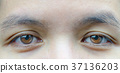 Macro shot of Asian middle aged woman brown eyes  37136203