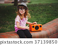 little hipster girl listens music on wireless 37139850