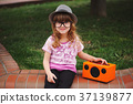 little hipster girl listens music on wireless 37139877