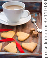 Wooden tray with a cup of coffee and biscuits  37141080