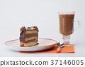 Piece of sponge cake with chocolate cream 37146005