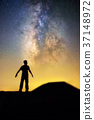 Milky way and human in silhouette 37148972