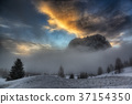 Sunset over the mountains and foggy hill 37154350