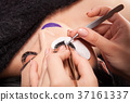 Woman getting an eyelashes treatment 37161337