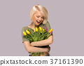 Woman holding a bouquet of tulips 37161390