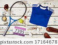 Racquet, shirt, sneakers and number 37164678