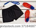 Black shorts, orange sneakers, whistle 37164687
