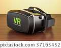 Virtual reality glasses on the wooden table 37165452