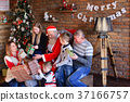 Santa Claus gives New Year gifts to big family in 37166757