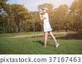 Asian woman golf player swinging driver golf club  37167463