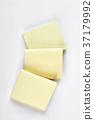 Stack of yellow sticks, white background. 37179992