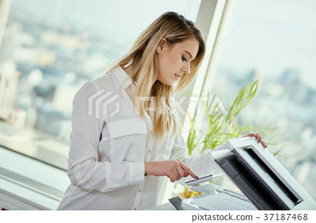 young businesswoman scans documents in the office 37187468
