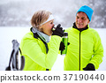 Senior couple cross-country skiing. 37190440
