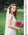 Beautiful bride outdoors in a park . Bridal style 37190572