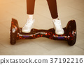 Girl rides on gyroscooter. Child's legs in 37192216