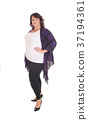 Full figured woman standing in tights 37194361