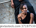 Young African American woman and man smoking 37197530