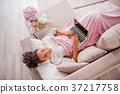 laptop sofa woman 37217758
