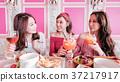 women chatting in restaurant 37217917