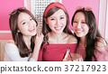 women selfie in restaurant 37217923