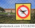 prohibition sign to fly with drones on the fence. 37218299