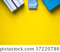 Gift boxes stack on yellow background 37220786