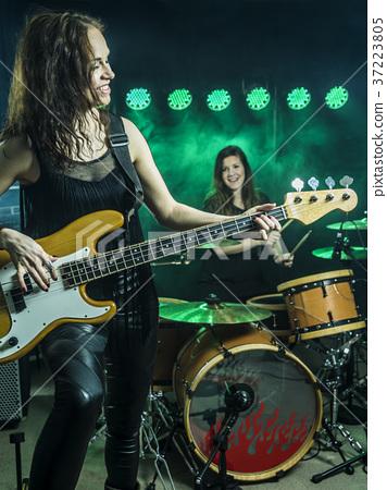 Beautiful women playing in the rock band 37223805