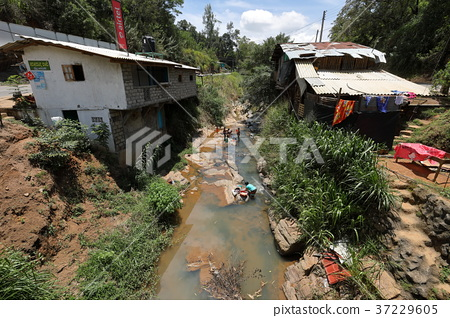 Washing clothes in a river in Sri Lanka 37229605