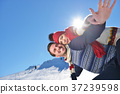 Loving couple playing together in snow outdoor. 37239598