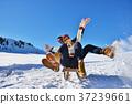Young Couple Sledding And Enjoying On Sunny Winter 37239661