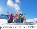 happy young family playing in fresh snow at 37239945