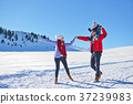 happy young family playing in fresh snow at 37239983