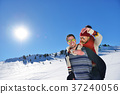 Young couple having fun on snow. Happy man at the 37240056