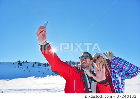 happy couple taking picture with smartphone selfie 37240132