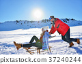 Young Couple Sledding And Enjoying On Sunny Winter 37240244