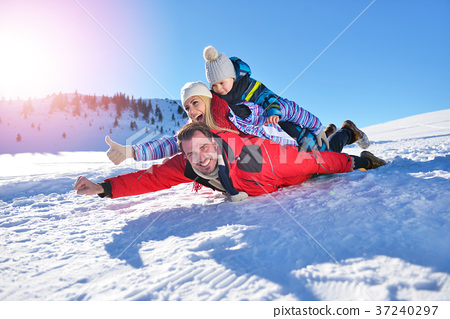 happy young family playing in fresh snow at 37240297