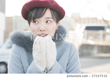 Young woman with gloves outdoor winter 37247510