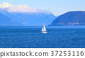 Small white sail yacht sailing in blue sea 37253116