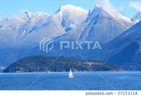 Small white sail yacht sailing in blue sea 37253118