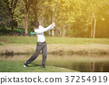 golf player swinging driver golf club  37254919