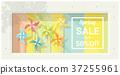 Spring sale window display with colorful pinwheels 37255961