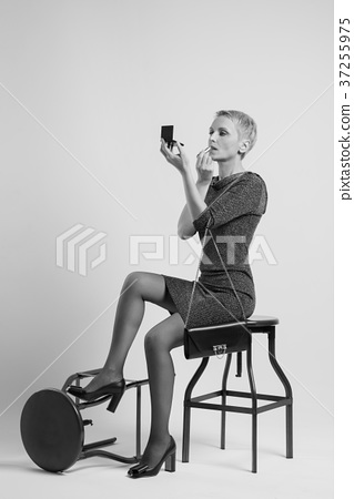 Phenomenal Sexy Woman Sits On A Bar Stool And Paints Lips Stock Photo Gamerscity Chair Design For Home Gamerscityorg
