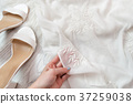 White transparent fabric in a female hand 37259038