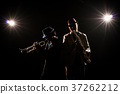 Musician Duo band playing the Trumpet with spot light and lens flare on the stage, musical concept 37262212