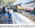 Multiethnic Travelers are looking at the map at the train station, Travel and transportation concept 37262224