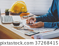 Architect designer hand working with smartphone 37268415