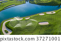 Aerial view of green golf course. 37271001