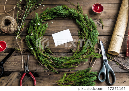 Pine leaves with decorative stuff for celebration 37271165