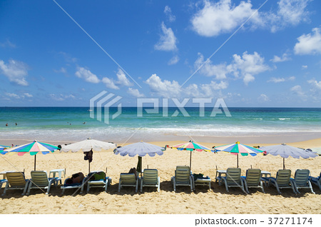 Beach chairs with sea scenery 37271174