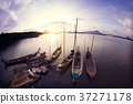 Wooden fishing boats with sunset scenery 37271178